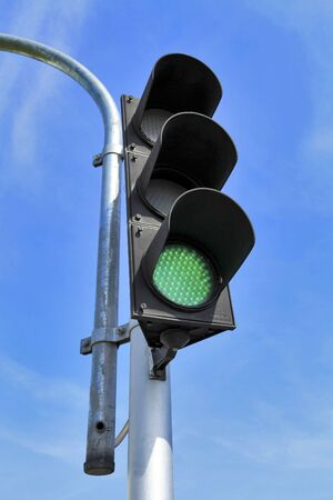 Traffic light on blue sky Bangkok Thailand photo