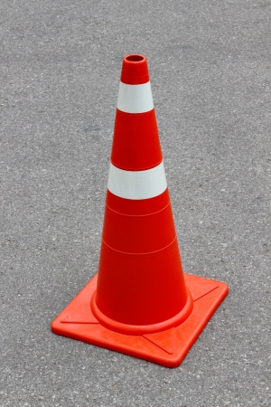 New traffic cone on the road Stock Photo - 19317659