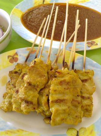 satay sauce: Pork satay Thai style in color dish with satay sauce