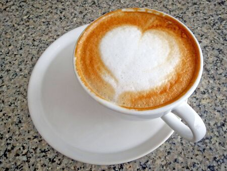 musetti: Cappuccino Coffee in white cup and heart topping Stock Photo