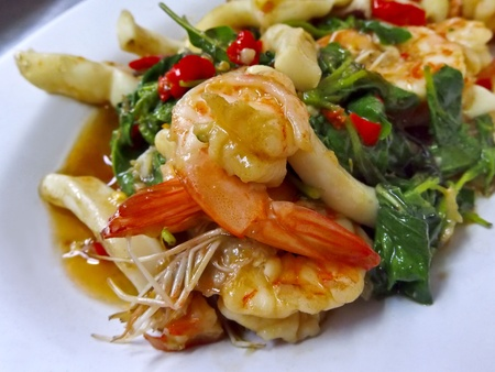 Shrimp and squid stir-fried basil leaves  Thai cuisine photo