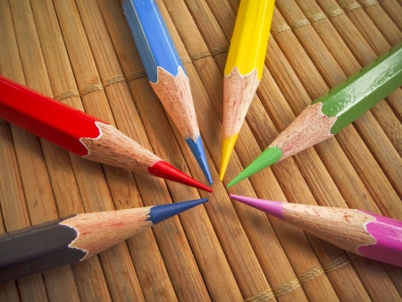 Pencil on bamboo pad background photo