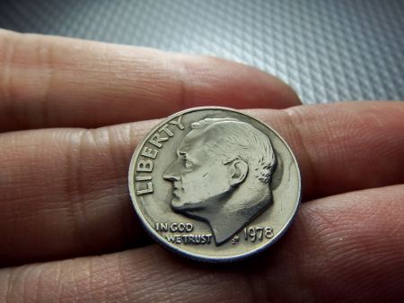 US Dollar Coins on finger photo