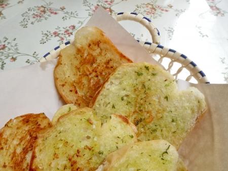 Garlic bread with herbs photo