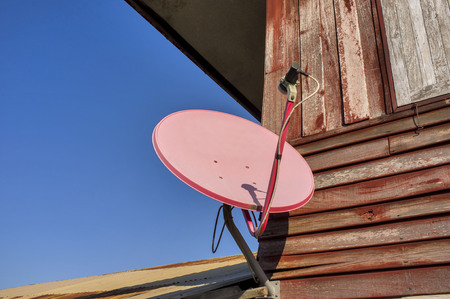 Satellite dish attached to the home. photo