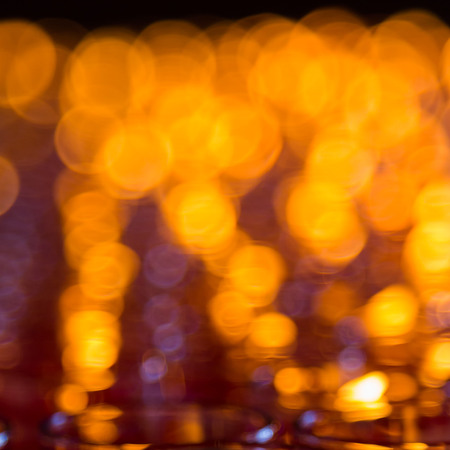 Bokeh of light candle in room photo