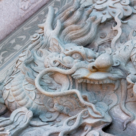 Dragon carved from stone photo