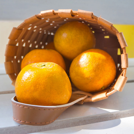 Oranges in the basket on white chair  photo