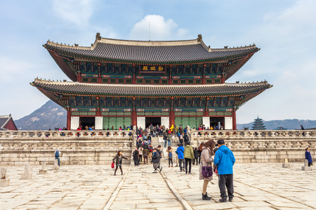 SEOUL, SOUTH KOREA - MARCH 08   Early morning tourists start to flock at Gyeongbokgung palace on March 08,2014 in Seoul, Korea  It is the largest palace of the South Korea built by the Joseon Dynasty