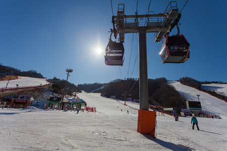 HONGCHEON, SOUTH KOREA - MARCH 7: Gondola ski lift taking skiers up to the top at Vivaldi Park Ski World in Hongcheon city, Gangwon Province, South Korea on March 7, 2014.