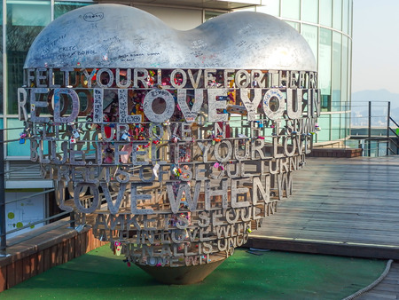 SOUTH KOREA -  MARCH 7 : Thousands of love padlocks at N Seoul Tower on March 7, 2014. Locks of love is a custom in some cultures which symbolize their love will be locked forever, Seoul South Korea 新闻类图片