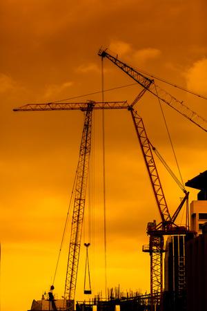 maneuverable: mobile crane operating, silhouettes