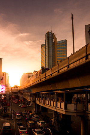 Bangkok, Thailand - October 4, 2014: BTS train rushes out of Asok station in Bangkok along Sukhumvit road. This elevated train system has helped considerably to reduce traffic congestion in the city, October 4, 2014 in Bangkok. Editorial