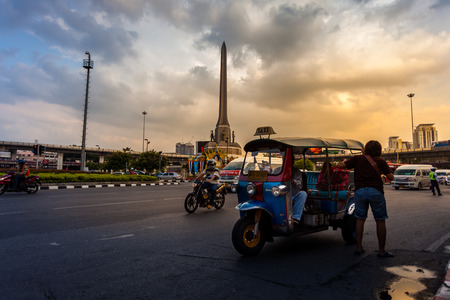 BANGKOK -OCTOBER 09, 2014: Traffic around Military Victory Monument in the evening. The monument has established in June 1941 to demonstrate a victory sign of war with France.