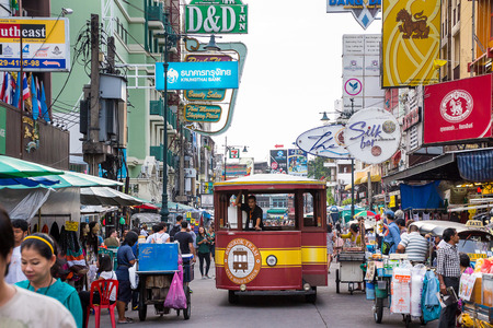 BANGKOK - OCTOBER 19: Bangkok tram for tourism running around Khao San Road in the evening. On rainy dark day. on October 19, 2014 in Bangkok, Thailand.