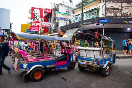 BANGKOK - OCTOBER 19: Tuk-tuks waiting passengers on Khao San Road in the evening. On rainy dark day. on October 19, 2014 in Bangkok, Thailand.