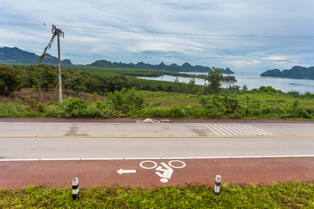 Bicycle Sign on the road After the rain. photo