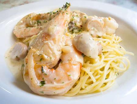 spaghetti cream sauce with shrimp topping photo