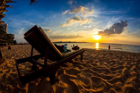 Tropical beach at sunset, Beach Chair on Pattaya Beach, Thailand, fisheye view photo