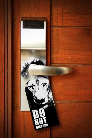 Do not disturb sign hang on door knob photo