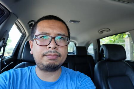 irritable: irritable man driving a car without seat belts