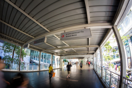 aisles: BANGKOK,THAILAND - JULE 9: Fisheye view, on sky walk to Erawan shrine, Erawan shrine which tourism famous attraction at Ratchaprasong Junction Thailand on June 9, 2015. Editorial