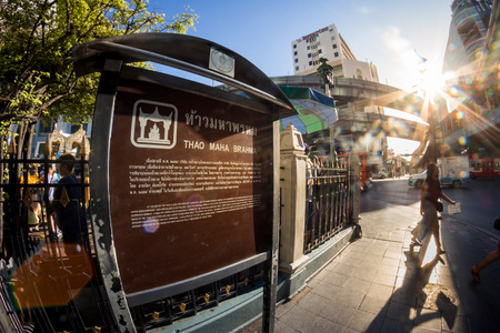 phrom: BANGKOK, THAILAND - JUNE 9:  Fisheye view with flare, Information board for Erawan shrine at Ratchaprasong Junction Thailand on June 9, 2015.