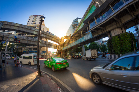 thanon: BANGKOK, THAILAND - JUNE 9: Traffic around Ratchaprasong road. the center of economic and modern tourism of Thailand on June 9, 2015.
