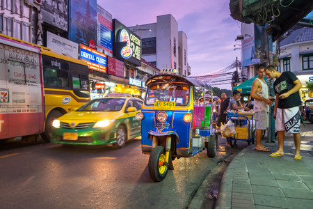 waiting passengers: BANGKOK - OCTOBER 17: Tuk-tuks waiting passengers on Khao San Road in the evening. on October 17, 2015 in Bangkok, Thailand. Editorial