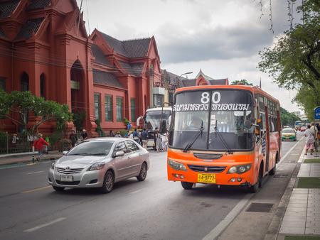 mini bus: BANGKOK,THAILAND SEP 29: Mini bus number 80 stop opposite Thawon watthu or red building Sanam Luang under dark raincloud, on SEPTEMBER 29, 2015 in Bangkok, Thailand.