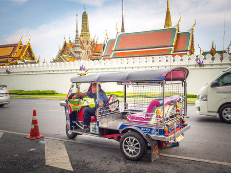 tuk tuk: BANGKOK,THAILAND SEP 29: Tuk Tuk vehicle park and waiting for passengers or tourists around The Grand Palace on SEPTEMBER 29, 2015 in Bangkok, Thailand.
