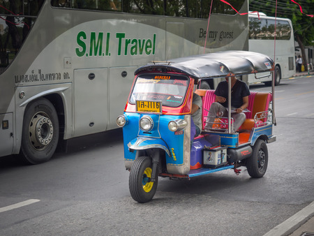tuk tuk: BANGKOK,THAILAND SEP 29: Tuk Tuk vehicle with passenger running around The Grand Palace on SEPTEMBER 29, 2015 in Bangkok, Thailand. Editorial