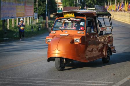 tuktuk: AYUTTHAYA, THAILAND - 6 DEC 2015: Tuk-Tuk driving on the road. Its a popular transportation for tourist in Ayutthaya historical city. on December 6 2015 in Ayutthaya Thailand. Editorial