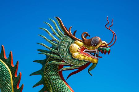 Chinese Dragon on the blue sky at Wat Muang, Ang Thong Province, Thailand.