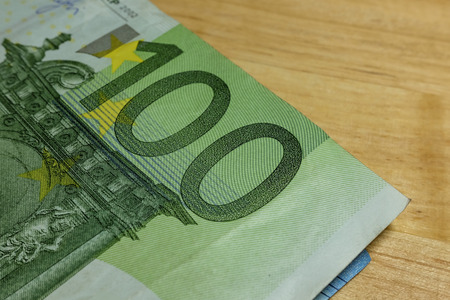 papermoney: Euro banknotes in salary brown envelope. Stock Photo