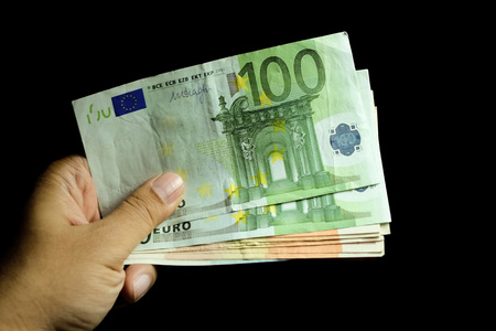 papermoney: Male hand holding euro money banknotes