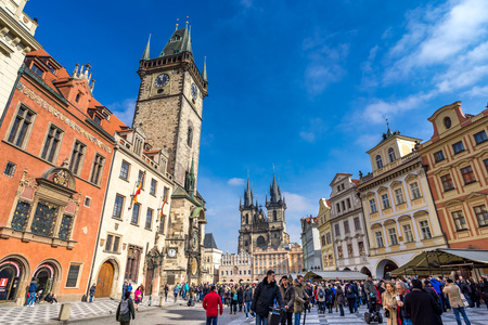 PRAGUE, CZECH REPUBLIC - MARCH 5, 2016: Unidentified tourists in the Old Town Square in front of Tyn Church and famous Astronomical Clock, Prague Czech, on March 5, 2016 Redakční