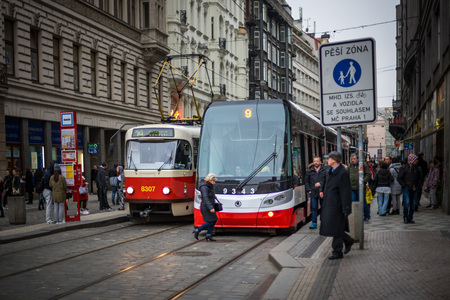 number 14: PRAGUE, CZECH REPUBLIC - MARCH 5, 2016: The vintage excursion tram number 14 and modern tram number 9 parade are goes on old town in Prague. on March 5, 2016 Editorial