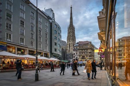 stephansplatz: VIENNA, AUSTRIA- MARCH 6, 2016: Urban life in the evening at Stephansplatz square, The geographical centre of Vienna. Vienna. Austria, on March 6, 2016