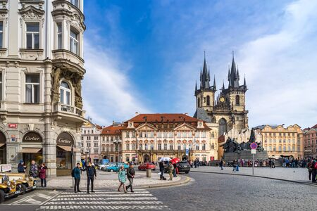 unesco in czech republic: PRAGUE, CZECH REPUBLIC - MARCH 5, 2016: Unidentified tourists in old town square in Prague, Tyn Cathedral of the Virgin Mary and monument of Jan Hus. Czech Republic, World Heritage Site by UNESCO. on March 5, 2016