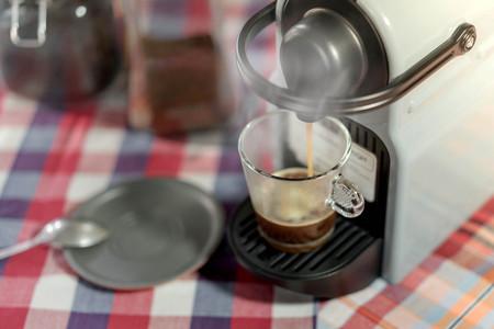 decaffeinated: machine serving espresso coffee in a glass cup
