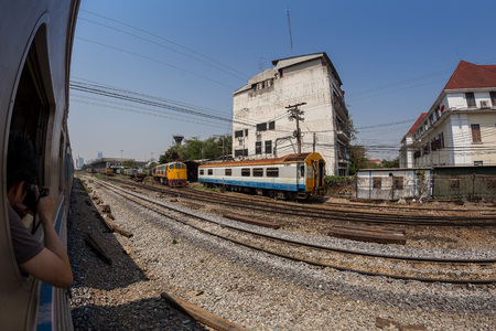 rapid steel: BANGKOK, THAILAND - April 11, 2015 : Fisheye view, Wayside view from train going to Hua Lamphong railway station on April 11, 2015 Bangkok Thailand. Editorial