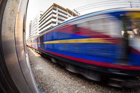 fast train: Fisheye, Fast train with motion blur.