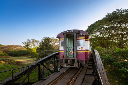 world war ii: KANCHANABURI, THAILAND - December 29, 2016: Train go on the bridge of river Kwai in Kanchanaburi, Thailand. The bridge was built by the Japanese Army during World War II. Nowadays is a famous tourist destination of the world.