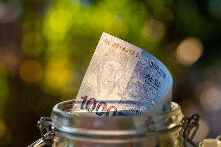 South Korea banknotes in glass jar.