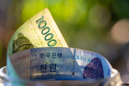 South Korea banknotes in glass jar. Stock Photo