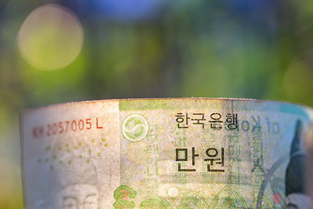 South Korea banknotes in glass jar. 스톡 콘텐츠