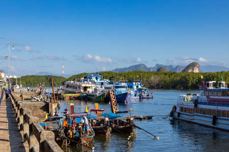 KRABI, THAILAND - JANUARY 23, 2020 - Beautiful natural view of boats, pier, mangrove forest and Khao Khanab Nam mountain at Krabi River, Krabi, Thailand.