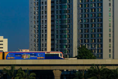 Bangkok-Thailand Mar 27 2020: BTS Sky train From Lat Phrao Station to Ratchayothin Station in evening time. faraway view