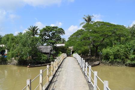 islet: bridge go to river islet in Vietnamese countryside Stock Photo